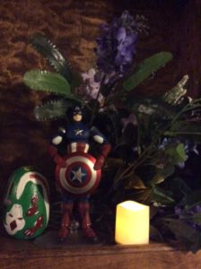 Captain America shrine with lilacs and pisanka